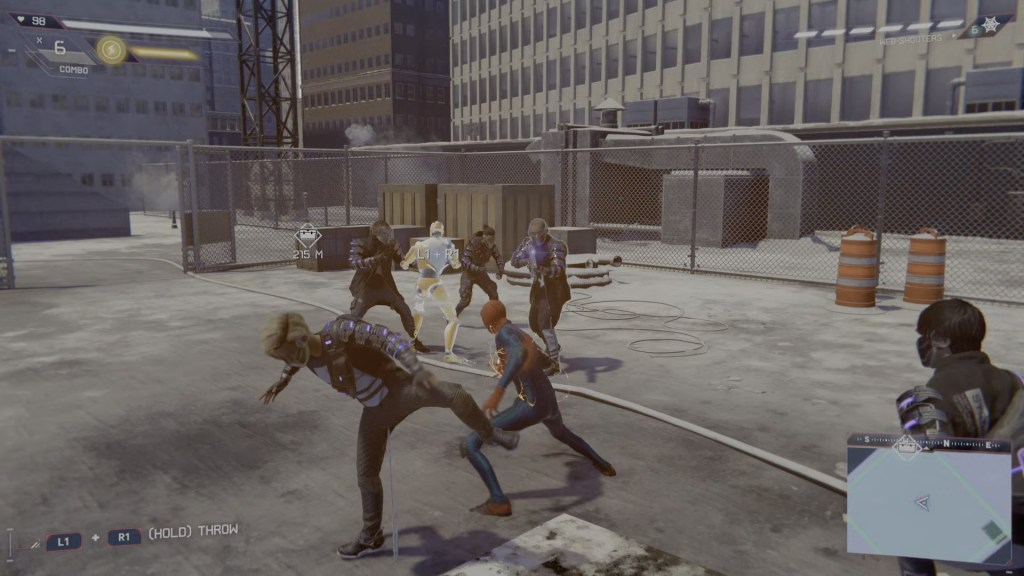 Miles Morales fights off some members of The Underground with the help of the decoy gadget.